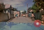 Image of narrow streets Kingston Jamaica, 1972, second 20 stock footage video 65675040554