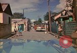 Image of narrow streets Kingston Jamaica, 1972, second 22 stock footage video 65675040554