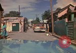 Image of narrow streets Kingston Jamaica, 1972, second 23 stock footage video 65675040554
