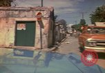 Image of narrow streets Kingston Jamaica, 1972, second 26 stock footage video 65675040554