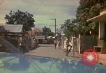 Image of narrow streets Kingston Jamaica, 1972, second 32 stock footage video 65675040554