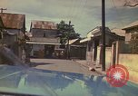 Image of narrow streets Kingston Jamaica, 1972, second 37 stock footage video 65675040554