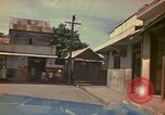 Image of narrow streets Kingston Jamaica, 1972, second 39 stock footage video 65675040554