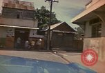 Image of narrow streets Kingston Jamaica, 1972, second 40 stock footage video 65675040554