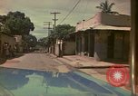 Image of narrow streets Kingston Jamaica, 1972, second 49 stock footage video 65675040554