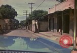 Image of narrow streets Kingston Jamaica, 1972, second 50 stock footage video 65675040554