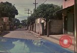 Image of narrow streets Kingston Jamaica, 1972, second 51 stock footage video 65675040554