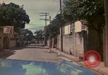 Image of narrow streets Kingston Jamaica, 1972, second 52 stock footage video 65675040554