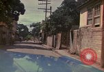 Image of narrow streets Kingston Jamaica, 1972, second 54 stock footage video 65675040554