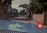 Image of narrow streets Kingston Jamaica, 1972, second 56 stock footage video 65675040554