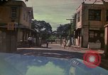 Image of narrow streets Kingston Jamaica, 1972, second 58 stock footage video 65675040554