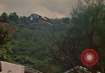Image of high rise buildings Jamaica, 1972, second 5 stock footage video 65675040564