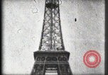 Image of Eiffel Tower Paris France, 1900, second 62 stock footage video 65675040582