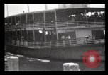 Image of Immigrants arriving at Ellis Island New York City USA, 1903, second 9 stock footage video 65675040610
