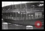 Image of Immigrants arriving at Ellis Island New York City USA, 1903, second 12 stock footage video 65675040610