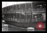 Image of Immigrants arriving at Ellis Island New York City USA, 1903, second 16 stock footage video 65675040610