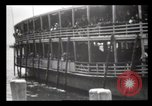 Image of Immigrants arriving at Ellis Island New York City USA, 1903, second 23 stock footage video 65675040610