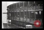 Image of Immigrants arriving at Ellis Island New York City USA, 1903, second 30 stock footage video 65675040610