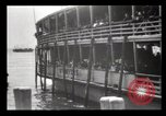Image of Immigrants arriving at Ellis Island New York City USA, 1903, second 34 stock footage video 65675040610