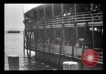 Image of Immigrants arriving at Ellis Island New York City USA, 1903, second 36 stock footage video 65675040610