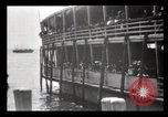 Image of Immigrants arriving at Ellis Island New York City USA, 1903, second 37 stock footage video 65675040610