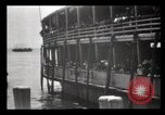Image of Immigrants arriving at Ellis Island New York City USA, 1903, second 39 stock footage video 65675040610