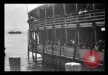 Image of Immigrants arriving at Ellis Island New York City USA, 1903, second 40 stock footage video 65675040610