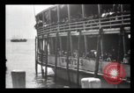 Image of Immigrants arriving at Ellis Island New York City USA, 1903, second 41 stock footage video 65675040610
