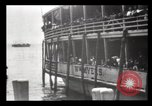 Image of Immigrants arriving at Ellis Island New York City USA, 1903, second 43 stock footage video 65675040610