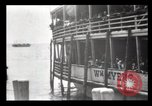 Image of Immigrants arriving at Ellis Island New York City USA, 1903, second 49 stock footage video 65675040610