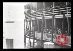 Image of Immigrants arriving at Ellis Island New York City USA, 1903, second 50 stock footage video 65675040610