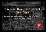 Image of Bargain Day New York City USA, 1903, second 2 stock footage video 65675040616