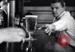 Image of Beer bar by Urbain Ledoux during prohibition New York City USA, 1932, second 38 stock footage video 65675040730