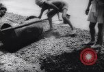 Image of Natives build World war 2 airfields in New Guinea India, 1944, second 45 stock footage video 65675040780