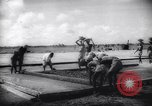 Image of Natives build World war 2 airfields in New Guinea India, 1944, second 52 stock footage video 65675040780
