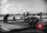 Image of Natives build World war 2 airfields in New Guinea India, 1944, second 53 stock footage video 65675040780