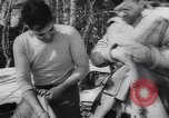 Image of Dog sled team rescues pilot United States USA, 1944, second 37 stock footage video 65675040790
