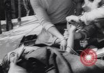 Image of Dog sled team rescues pilot United States USA, 1944, second 43 stock footage video 65675040790