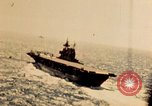 Image of Navy fighter aircraft landing on USS Essex Pacific Theater, 1945, second 16 stock footage video 65675040813