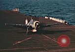 Image of Navy fighter aircraft landing on USS Essex Pacific Theater, 1945, second 34 stock footage video 65675040813