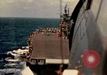 Image of Navy fighter aircraft landing on USS Essex Pacific Theater, 1945, second 36 stock footage video 65675040813