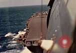 Image of Navy fighter aircraft landing on USS Essex Pacific Theater, 1945, second 38 stock footage video 65675040813