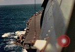 Image of Navy fighter aircraft landing on USS Essex Pacific Theater, 1945, second 39 stock footage video 65675040813