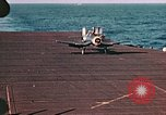 Image of Navy fighter aircraft landing on USS Essex Pacific Theater, 1945, second 49 stock footage video 65675040813