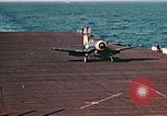 Image of Navy fighter aircraft landing on USS Essex Pacific Theater, 1945, second 50 stock footage video 65675040813