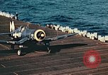 Image of Navy fighter aircraft landing on USS Essex Pacific Theater, 1945, second 53 stock footage video 65675040813