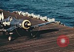 Image of Navy fighter aircraft landing on USS Essex Pacific Theater, 1945, second 54 stock footage video 65675040813