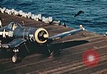 Image of Navy fighter aircraft landing on USS Essex Pacific Theater, 1945, second 55 stock footage video 65675040813