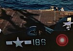 Image of Navy fighter aircraft landing on USS Essex Pacific Theater, 1945, second 60 stock footage video 65675040813