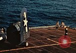 Image of Navy fighter aircraft landing on USS Essex Pacific Theater, 1945, second 61 stock footage video 65675040813